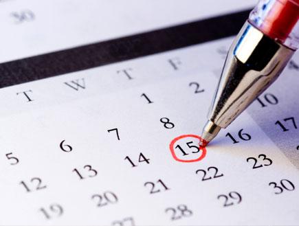 לוח שנה עם עט(istockphoto)