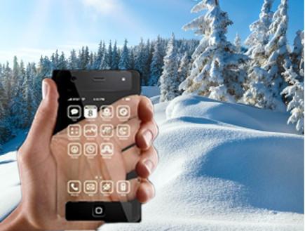 סמארטפון בשלג (אילוסטרציה) (צילום: אילוסטרציה)