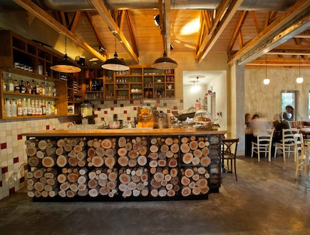 """Vine Road "" is a rustic bistro located in a small country near Jerusalem.  Pastoral structure attached to a large..."