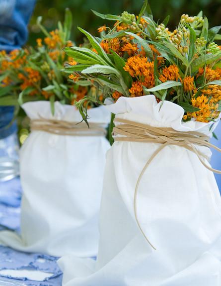 שולחן חג-אגרטלים עם פרחים בעיצוב שלומי ומוליק