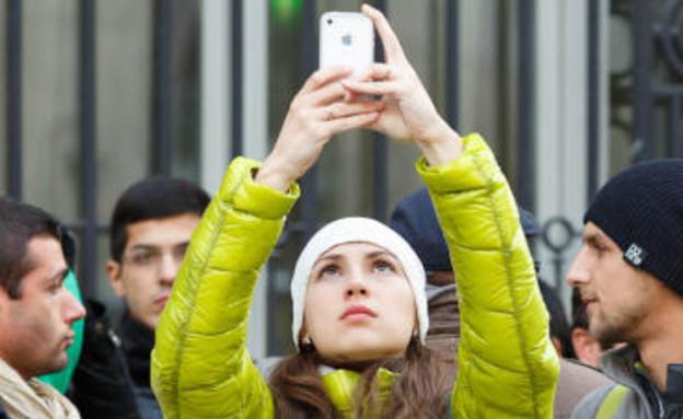 מעריצי אייפון (צילום: סטפן שנקלנד, Cnet)