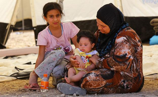 פליטים כורדים באזור סינג'ר (צילום: AP)