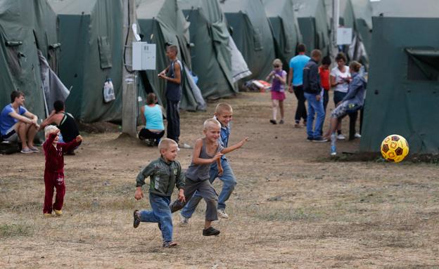 יותר מ-800 אלף פליטים חצו לרוסיה, מחנה פליטים במער (צילום: רויטרס)