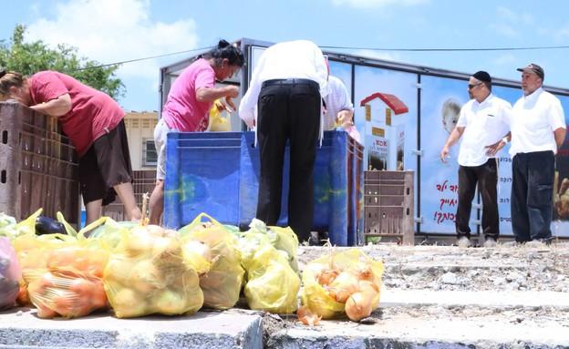 חסדי נעמי - חלוקת מזון בשדרות (צילום: מיכאל עמרם)
