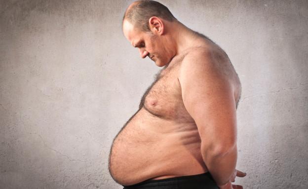 אדם שמן עצוב (צילום: Thinkstock)