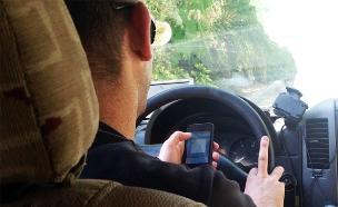 נוהג עם סלולרי (צילום: חדשות 2)