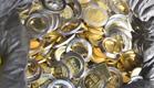 """מטבעות """"ברמות גימור שונות"""" (צילום: חטיבת דובר המשטרה)"""