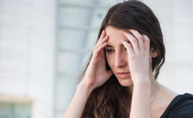 נערה בוכיה (צילום: Shutterstock)