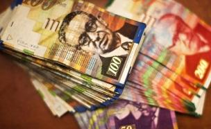 מתחילים לשלם פחות (צילום: רויטרס)