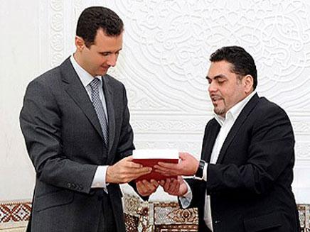 קונטאר עם הנשיא הסורי אסד (צילום: חדשות 2)