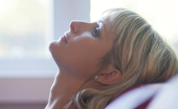 אישה דואגת (צילום: shutterstock)