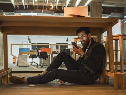 טלפון במשרד (צילום: Getty images ,Getty images)