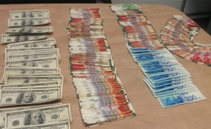 כסף שנתפס בחקירת הפרשה (צילום: דוברות המשטרה)