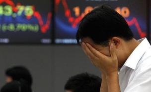 הבורסות צונחות (צילום: רויטרס)
