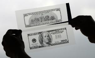 חוקר פרטי מחזיק נגטיבים של שטרות של 100 דולר בקולומביה (צילום: ap)