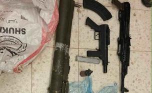 הנשקים שהוסלקו במשאית (צילום: דוברות המשטרה)