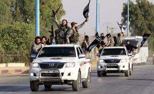 """פעילי דאע""""ש בעירק (צילום: רויטרס)"""