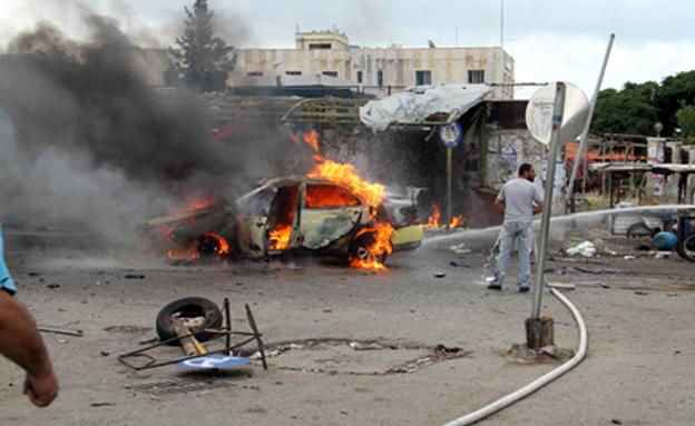 מתקפה חריגה במעוזי אסד, הבוקר (צילום: רויטרס)