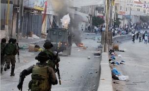 במהלך הפעולה - עימותים בקלנדיה (צילום: רויטרס)