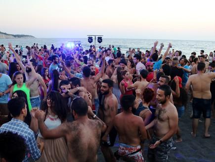 מסיבת חוף בסוריה (צילום: אימג'בנק/AFP)