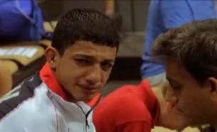 ילד איראני (צילום: צילום מסך פייסבוק אל ג'זירה)