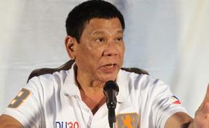 """""""אם תשאל שאלות, אקלל אותך"""". נשיא הפיליפי (צילום: רוייטרס)"""