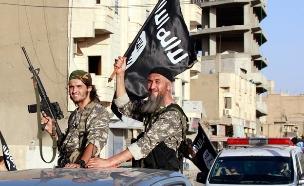 """""""נגביר את צעדינו נגד דאע""""ש"""" (צילום: רויטרס)"""