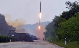 שיגור טיל צ. קוריאני (צילום: רויטרס)