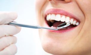 אישה אצל רופא שיניים (צילום: shutterstock: YanLev)