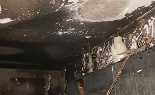 השריפה בבניין בצפת (צילום: דוברות כבאות והצלה מחוז צפון)