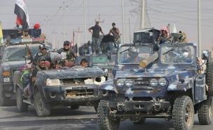 """הקרב על מוסול: מאות אנשי דאע""""ש נהרגו (צילום: רויטרס)"""