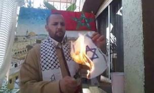דגל ישראל שרוף (צילום: צילום מסך)