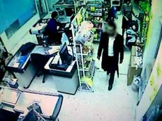 הטרדה מינית במכולת מצלמות אבטחה (צילום: מצלמות אבטחה)