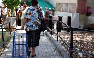 """2.5 מיליון חיים בעוני"" (צילום: פלאש 90)"