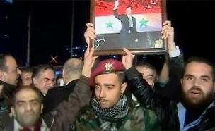 חגיגות בחסות המשטר בחאלב, הערב (צילום: רויטרס)