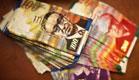 שטרות כסף ישראלי, שקל (צילום: רויטרס)