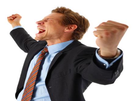 איש עסקים מאושר (צילום: Vostock Photo, Istock)