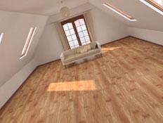 עליית גג גדולה באלכסון עם ספה, חלונות ורצפת פרקט (צילום: istockphoto)