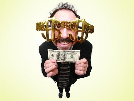 דולרים בעיניים (צילום: istockphoto)
