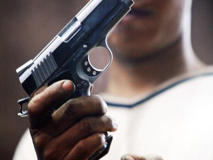 אקדח, אילוסטרציה  (צילום: רויטרס)