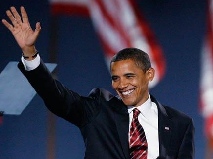 הנשיא הנבחר, ברק אובמה, בנאום הניצחון בשיקגו (צילום: רויטרס)