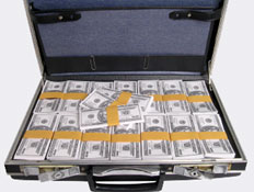 מזוודת דולרים (צילום: Kenneth C. Zirkel, Istock)