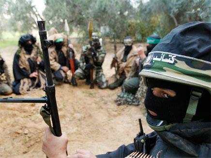 """פעילי חמאס. """"נשחרר את ירושלים"""" (צילום: רויטרס)"""