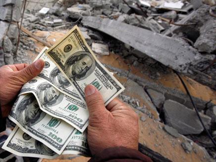 כסף לשיקום או כסף לרקטות? (צילום: רויטרס)