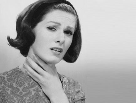 אשה עם כאב גרון (צילום: George Marks, GettyImages IL)