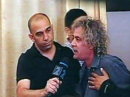 רינו צרור מתפרץ בנאומו של משה קצב (חדשות 2) (צילום: חדשות 2)