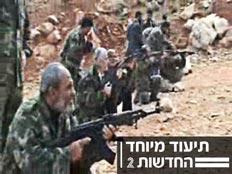 בכירי חמאס מתאמנים בירי (מתוך פורום חמאס) (צילום: מתוך פורום חמאס)