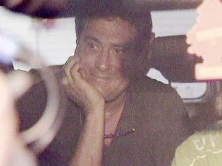 דודו טופז בדרכו למעצר (צילום: חדשות 2)