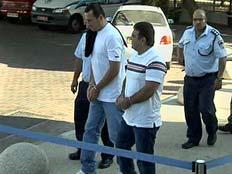 החשודים בעת מעצרם
