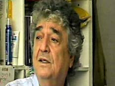 דודו אלהרר בראיון לפעיל שלום עכשיו (צילום: חדשות 2)